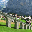 Mountain rail road in Muerren, famous Swiss skiing resort - Stock Photo