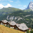 Holiday cottages in Muerren, famous Swiss skiing resort - Stock Photo