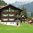Traditional Swiss cottage against Eiger mountain in Jungfrau r - Stockfoto