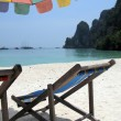 Sun chair under umbrella on a tropical sandy beach of Phi-Phi is — Stock Photo