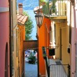 Narrow street of Varenna town at the lake Como, Italy - Stock Photo