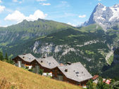 Holiday cottages in Muerren, famous Swiss skiing resort — Stock Photo