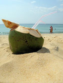 Coconut cocktail on the sandy beach — Stock Photo