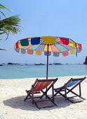 Sun chair under umbrella on a tropical sandy beach of Phi-Phi is — Stock Photo