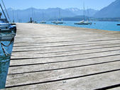 Wooden pier against lake Thun and Alps. Switzerland — Stock Photo