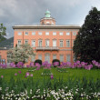 Classical mansion and lilac tulips in foreground. Lugano, Switz - Stock Photo