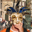 Tourist in the joker mask at San Marco square in Venice — Stock Photo