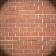 Light spot on a brick wall - Stock Photo
