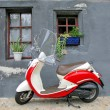 Trendy moped against old building. Fribourg, Switzerland — Stock Photo