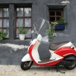 Trendy moped against old house. Fribourg, Switzerland - Stock Photo