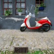 Trendy moped against old building. Fribourg, Switzerland - Stock Photo