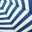 Striped sun umbrella — Stock Photo