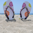Flip-flops in the black sand of Tenerife island, Canaries — Stock Photo