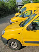 Row of yellow service cars — Stock Photo