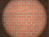Light spot on a brick wall — Stock Photo