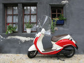 Trendy moped against old house. Fribourg, Switzerland — Stock Photo