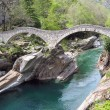 Ancient double arch stone bridge in Verzasca valley, Switzerland — Stock Photo