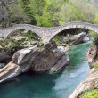 Stock Photo: Ancient double arch stone bridge in Verzasca valley, Switzerland