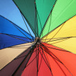 Spectrum colored umbrella — Stock Photo