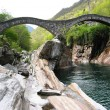 Stock Photo: ancient double arch bridge in verzasca valley switzerland