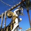 Neptune on the prow of old Spanish galleon. Genoa, Italy - Stock Photo