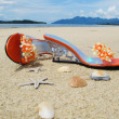Trandy shoes on the sand of Langkawi island, Malaysia - Stockfoto