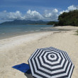 Sun umbrella on a sandy beach of Langkawi island Malyasia — Stock Photo