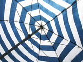 Striped beach umbrella — Stock Photo
