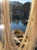 Fishnet and boat. Camogli, Italy — Stock Photo