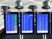 Airport departure board information — Stock Photo