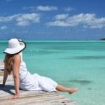Girl on the wooden jetty looking to the ocean. Exuma, Bahamas — Stock Photo #24171875