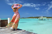 Girl on the wooden jetty looking to the ocean. Exuma, Bahamas — Stock Photo