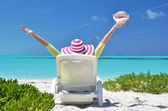 Girl with a shell on the sunbed looking to the ocean. Exuma, Bah — Stock Photo