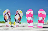Two pairs of flip-flops against Atlantic. Exuma, Bahamas — Stock Photo