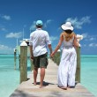 Couple on the wooden jetty - Stock Photo
