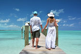 Couple on the wooden jetty — Stock Photo