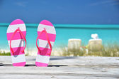 Flip-flops against ocean. Exuma, Bahamas — Stock Photo