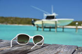 Sunglasses on the wooden jetty — Stock Photo