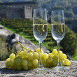 Stock Photo: Pair of champagne glasses and grapes. Bellinzona, Switzerland
