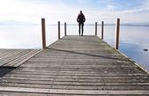 Girl on the pier. Lake of Zug, Switzerland — Stock Photo