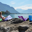 Stock Photo: Young woman taking sunbath at Geneva lake, Switzerland