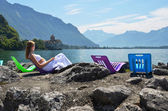 Young woman taking sunbath at Geneva lake, Switzerland — Stock Photo