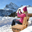 Girl taking a photo in the Swiss Alps — Stock Photo