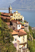 Madonna del Sasso, medieval monastery on the rock overlook lake — Stock Photo