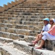 Stock Photo: Couple in Kourion's amphiteater. Cyprus