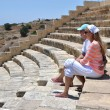Stock Photo: A couple in the Kourion's amphiteater. Cyprus