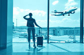 Girl at the airport window — Stock Photo