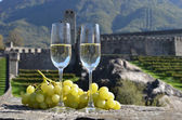 Pair of champagne glasses and grapes. Bellinzona, Switzerland — Stock Photo
