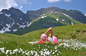 Girl in an Alpine meadow. Melchsee-Frutt, Switzerland — Stock Photo