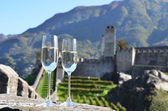 Pair of champagne glasses and grapes. Bellinzona, Switzerland — Stock Photo